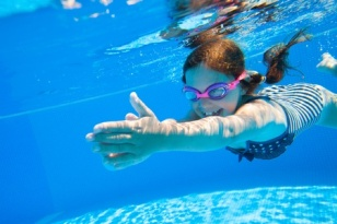 45903154 - little girl deftly swim underwater in pool