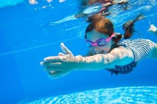 45903154 - little girl deftly swim underwater in pool