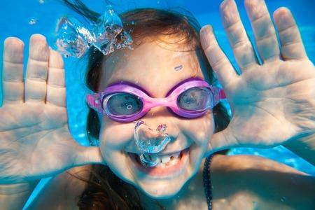 45903156 - funny underwater portrait of  cheerful girl